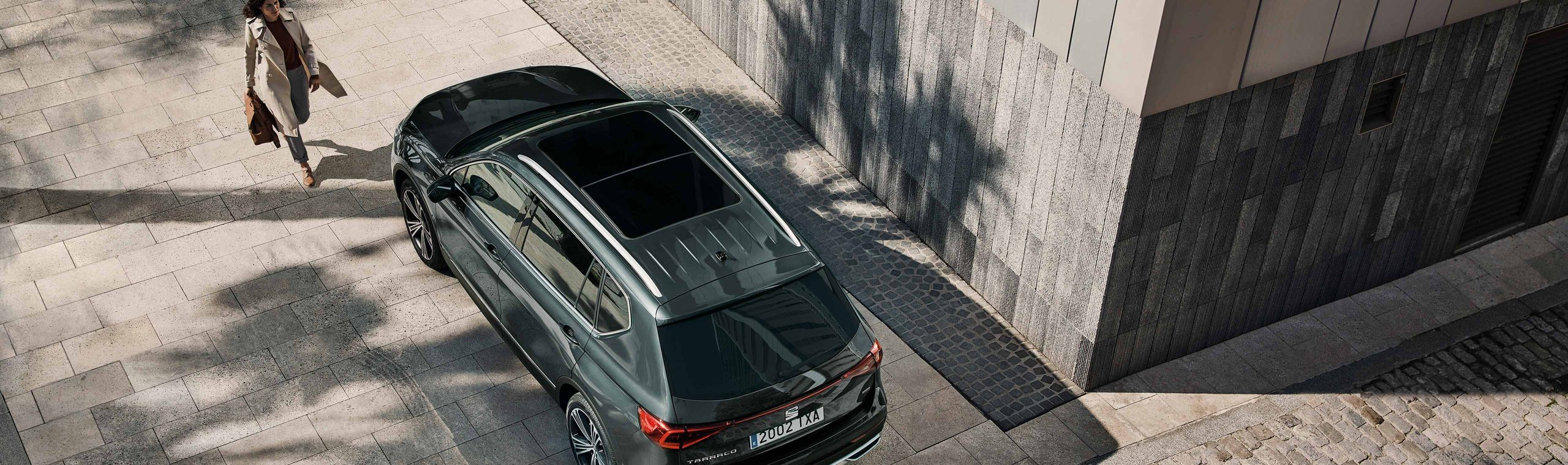 new-seat-tarraco-7-seater-suv-exterior-view-of-car-with-woman.jpg